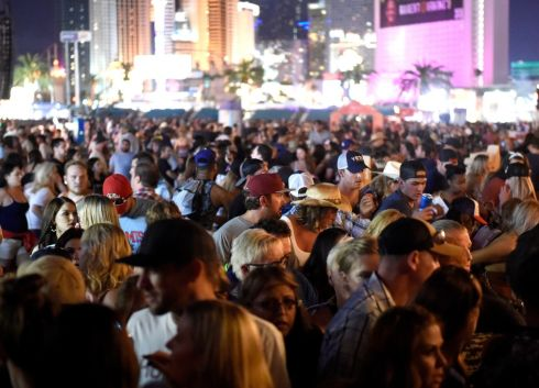 Crowds gather at the festival after the gunfire began.  Photograph: David Becker/Getty Images