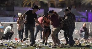 People carry a person at the Route 91 Harvest country music festival after a shooting. Photograph: David Becker/Getty Images