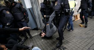 Spanish police officers drag a man as they try to disperse voters arriving to a polling station in Barcelona on October 1st. Photograph: Pau Barrena/AFP/Getty