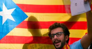 A man holds a Catalan pro-independence 'Estelada' flag during a demonstration in support of the referendum in Catalonia on Sunday. Photograph: Jorge Guerrero/AFP/Getty Images