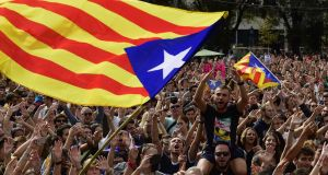 People shout slogans as they wave Catalan pro-independence 'Estelada' flags during a protest in Barcelona on Monday. Photograph: Pierre-Philippe Marcou/AFP/Getty Images