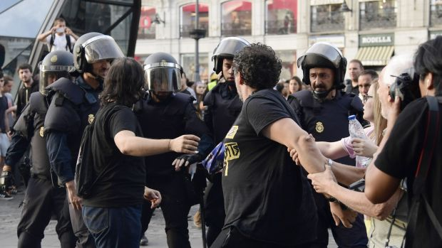Protesters confront Spanish National police officers during a demonstration at Puerta del Sol square on Sunday. Phogoraph: Javier Soriano/AFP/Getty Images