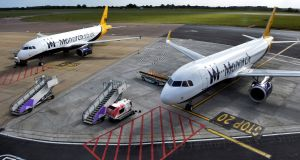 Two grounded Monarch aircraft at Luton airport after the airline ceased trading. Photograph: Mary Turner/Reuters