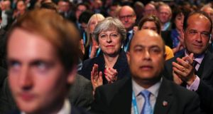 Brexit debate: Theresa May listens to Philip Hammond's conference speech. Photograph: Hannah McKay/Reuters