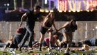 People run from the Route 91 Harvest country music festival in Las Vegas, Nevada, where a gunman opened fire killing more than  50 people. Photograph: David Becker/Getty Images