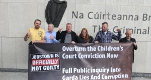 Defendants Paul Kiernan, Keith Preston, Declan Kane, Antoinette Kane, Tommy Kelly and Peter Herbert outside Dublin Circuit Criminal Court after they were all found not guilty on charges of  false imprisonment of then-tánaiste Joan Burton at a water charges protest in Jobstown in 2014. Photograph: Collins Courts