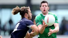 Ireland's Sean Cavanagh in action against  Jackson Geary of Victoria Football League in Melbourne in 2014. Cavanagh is club-tied with Moy this year.  Photograph: Cathal Noonan/Inpho