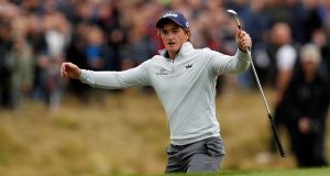 Ireland's Paul Dunne celebrates after chipping in on the 18th during the final round to win the British Masters. Photo: Lee Smith/Reuters