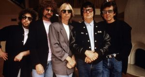 Tom Petty (centre) with the Traveling Wilburys in the late 1980s - also present are, from left, Bob Dylan, Jeff Lynne, Roy Orbison and George Harrison. Photograph: Neal Preston/Rhino Records/Reuters