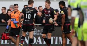 Saracens' Liam Williams celebrates a try with Owen Farrell. The club has incurred losses of a cumulative £36.3m or so in the last seven years. Photograph: Mark Kerton/PA