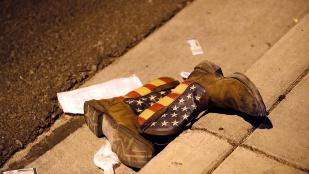 Cowboy boots on the street outside the concert venue. Photograph: Steve Marcus/Las Vegas Sun/Reuters