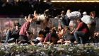 Concert-goers scramble for shelter at the Route 91 Harvest country music festival in Las Vegas after    gunman Stephen Paddock  opened fire leaving at least 59 people dead and more than 527 injured before taking his own life.  Photograph:  David Becker/Getty