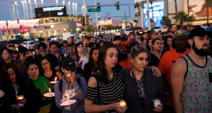 Mourners attend a candlelight vigil at the corner of Sahara Avenue and Las Vegas Boulevard for the victims of Sunday night's mass shooting. Photograph: Drew Angerer/Getty Images