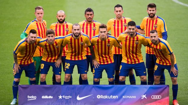 Players pose for a team photo wearing shirts in the colours of the Catalan flag. Photograph: Getty Images
