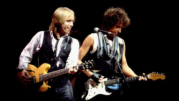 Tom Petty and Bob Dylan in concert in Chicago in 1986. Photograph: Paul Natkin/WireImage/Getty Images