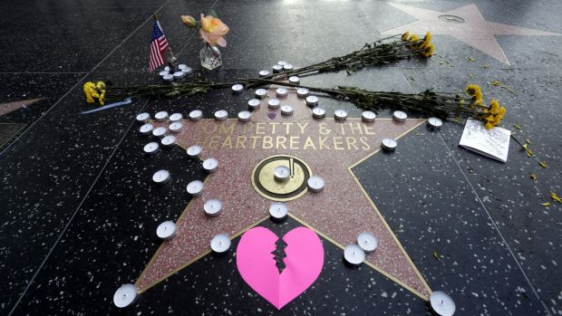 Tom Petty's star on the Hollywood Walk of Fame is adorned with flowers, candles and cards in Hollywood. Photograph: Mike Nelson/EPA