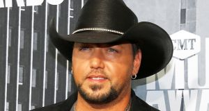 Country music singer Jason Aldean: 'We are all humans and we are all Americans and it's time to start acting like it and stand together as one!' Photograph: Jamie Gilliam/Reuters