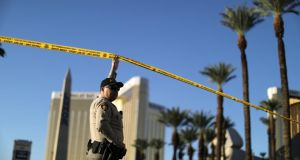 Mandalay Bay massacre: a police officer on the closed Las Vegas Strip, next to the site of the Route 91 Harvest music festival. Photograph: Lucy Nicholson/Reuters