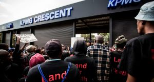 Members of political party Black First Land First (BLF) demonstrate in front of the offices of financial audit, tax and advisory company KPMG in Johannesburg, South Africa.