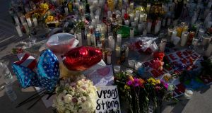 A makeshift memorial for the victims of Sunday night's mass shooting stands at an intersection of the north end of the Las Vegas Strip. Photograph: Drew Angerer/Getty Images