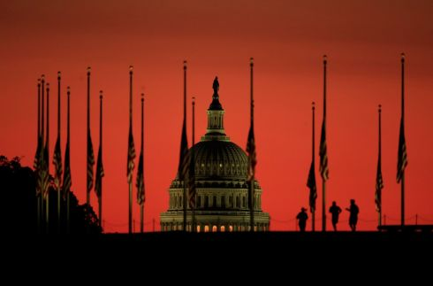 AT HALF-MAST: The US Capitol dome behind a column of US flags standing at half-mast as the sun rises on Tuesday, October 3rd, 2017, on the National Mall in Washington, the day after a mass shooting resulted in the deaths of at least 59 people in Las Vegas. Photograph: Manuel Balce Ceneta/AP Photo