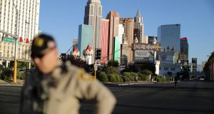 A police officer stands in front of the closed Las Vegas Strip next to the site of the Route 91 music festival mass shooting outside the Mandalay Bay Resort and Casino in Las Vegas. Photograph: Lucy Nicholson/Reuters