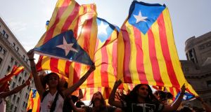 Catalan separatists wave flags in Barcelona. Photograph: Enrique Calvo/Reuters