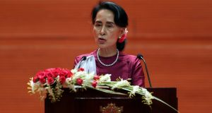 Aung San Suu Kyi delivers a televised speech to the nation at the Myanmar International Convention Centre in Naypyitaw, Myanmar in September. Photograph: Aung Shine Oo/AP