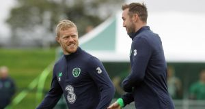 Daryl Horgan shares a joke with  Aiden McGeady during Ireland training at Abbotstown. Photograph: Lorraine O'Sullivan/Inpho