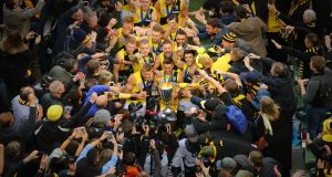 Richmond Tigers celebrate with the the AFL Premiership Cup after winning the 2017 AFL Grand Final against the Adelaide Crows at the Melbourne Cricket Ground. Photograph: Scott Barbour/AFL Media/Getty