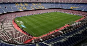 Barcelona taking on Las Palmas in front of a deserted Camp Nou. Photograph: Albert Gea/Reuters