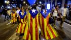 Referendum: Catalans wear pro-independence flags in Barcelona on Tuesday. Photograph: Alberto Estevez/EPA