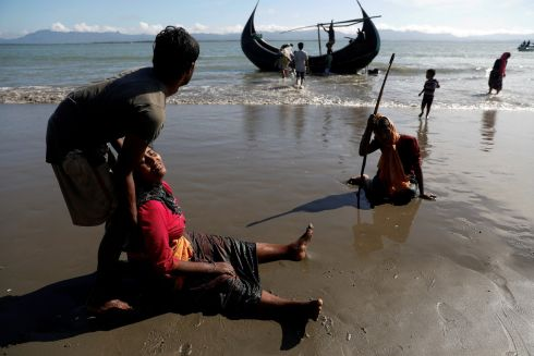 Over half a million Rohingya refugees have fled their homes in Myanmar since violence erupted in late August. Here are images taken over the last fortnight.. Rohingya refugees collapse from exhaustion as they arrive by a small wooden boat from Myanmar to the shore of Shah Porir Dwip, in Teknaf, near Cox's Bazar in Bangladesh. Photograph: Damir Sagolj  / Reuters