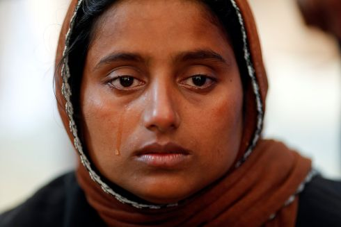 Nur Fatema, a survivor, cries over the body of her nine month old son who died after a boat with Rohingya refugees capsized as they were fleeing Myanmar. Photograph: Damir Sagolj / Reuters