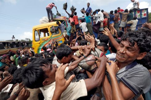 Rohingya refugees scuffle as aid is distributed in Cox's Bazar.  Photograph: Cathal McNaughton / Reuters