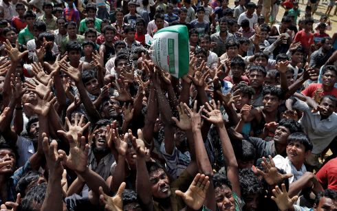Rohingya refugees react as aid is distributed in Cox's Bazar, Bangladesh. Photograph: Cathal McNaughton /Reuters