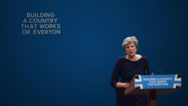 Theresa May's speech: letters begin to fall off the backdrop during the British prime minister's keynote appearance at the Conservative Party conference in Manchester. Photograph: Carl Court/Getty