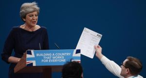 P45: the comedian Simon Brodkin, aka Lee Nelson, hands Theresa May a fake P45 at the Conservative Party conference in Manchester. Photograph: Carl Court/Getty