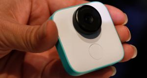 Clip, snap and store: A Google Clips camera is held during a launch event in San Francisco on Wednesday. Photograph: Stephen Lam/Reuters.