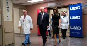 US president Donald Trump and first lady Melania Trump walk with doctors after visiting shooting victims at the University Medical Centre in Las Vegas, Nevada. Photograph: Doug Mills/The New York Times