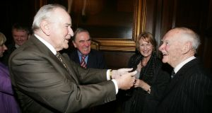 Former taoiseach Albert Reynolds meeting former taoiseach Liam Cosgrave after he spoke at the launch of a biography of John A Costello  by David McCullagh in Dublin's Mansion House in 2010. Photograph: Alan Betson