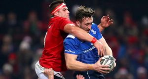 Munster's CJ Stander and Jack Conan of Leinster battle for the ball. They could also be battling for Ireland number 8 shirt. Photograph: James Crombie/Inpho