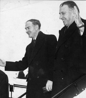 The taoiseach Sean Lemass, with Fine Gael leader Liam Cosgrave at Dublin Airport before leaving for talks in Strasbourg in January 1966.  Photograph: Tommy Collins/The Irish Times