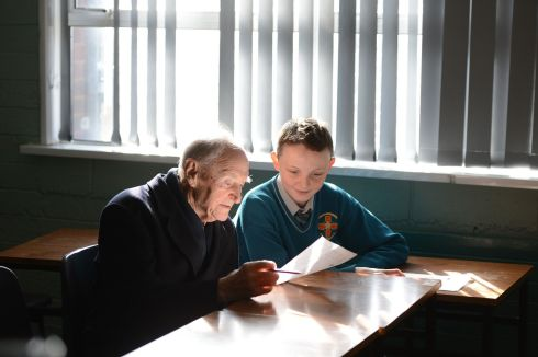 Former taoiseach Liam Cosgrave whose father WT Cosgrave attended CBS James Street, seated beside student Morgan Campbell  during a Gathering event in 2013 of former pupils at the school in Basin lane, Dublin. Photograph: Alan Betson/The Irish Times