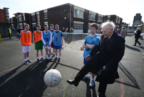 Former taoiseach Liam Cosgrave plays football with students during at the CBS James Street in Basin lane in 2013.  Photograph: Alan Betson/The Irish Times