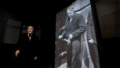 Former taoiseach Liam Cosgrave with a photograph of his father at the GPO Witness History Visitor Centre during its official opening in 2016.  Photograph: Brenda Fitzsimons/The Irish Times