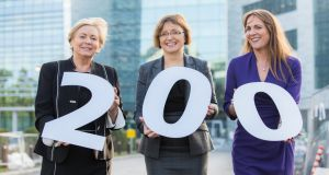 Pictured in front of Microsoft's new campus which is in the final stages of construction are Minister for Enterprise  Frances Fitzgerald ; Cathriona Hallahan, managing director, Microsoft Ireland; and Lisa Dillon, managing director, EMEA Inside Sales