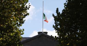 Flags fly at half mast at Leinster House in Dublin after the death of former taoiseach Liam Cosgrave. Photograph: Niall Carson /PA Wire.