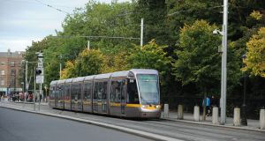 A woman who tried to force children off Luas trams because she believed they were in danger from a paedophile has been found not guilty of attempted abduction by reason of insanity.