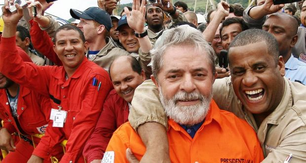Brazil's president Luiz Inacio Lula da Silva (second from right) greets employees of Brazilian oil giant Petrobras during the opening ceremony of the Petrobras 51 oil rig near Rio de Janeiro, in 2008. Photograph: Ricardo Stuckert/Reuters